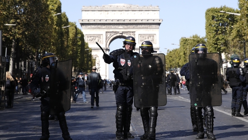 Police secure a street near the Champs Elysees during the yellow vest movement demonstration today