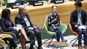 Greta Thunberg speaks as UN Secretary-General Antonio Guterres (L) and climate activist Bruno Rodriguez (R) listen at the start of the UN Youth Climate Summit