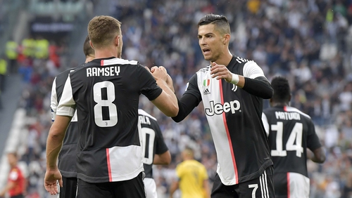 Ramsey and Ronaldo celebrate a goal for Juventus in their 2-1 victory