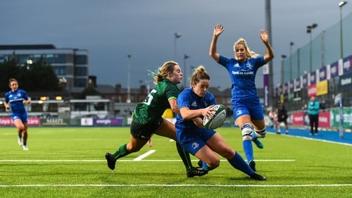Grace Miller scores Leinster's third try despite being tackled by Beibhinn Parsons of Connacht
