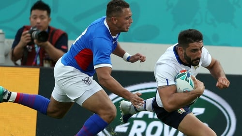 Tito Tebaldi of Italy gets over for a try