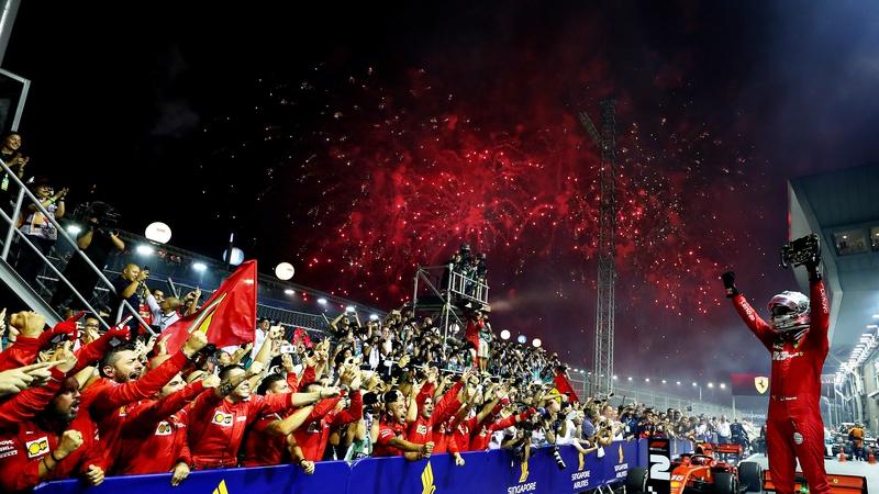 Vettel wins Singapore GP after pit-stop flashpoint