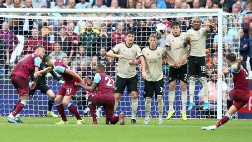 Aaron Cresswell scores from a free-kick