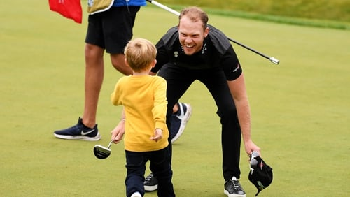 Willett celebrates after the last with his son