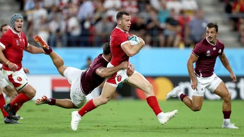 Wales' Gareth Davies is tackled by Georgia's Davit Kacharava