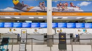 Empty Thomas Cook check-in desks at Gatwick Airport in England today