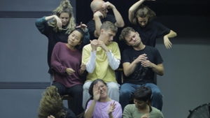 The cast of Mám in rehearsal
