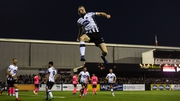 Seán Hoare soars high as he celebrates his goal at Oriel Park