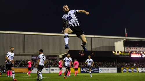 Seán Hoare soars high as he celebrates scoring the opener at Oriel Park