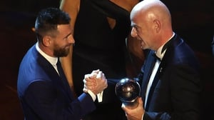 Gianni Infantino presents Lionel Messi with his award at La Scala in Milan