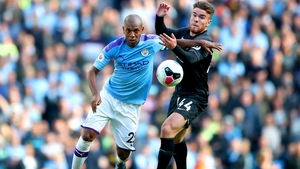 Aaron Connolly (R) in action against Manchester City's Fernandinho last month