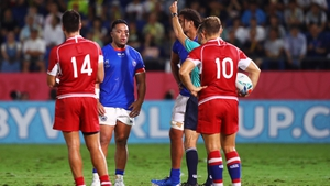 Romain Poite showsMotu Matu'u of Samoa a yellow card