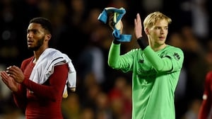 Caoimhin Kelleher (R) applauds the fans after Liverpool's win