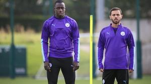 Benamin Mendy (L) and Bernardo Silva at Manchester City training