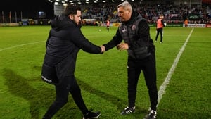 Shamrock Rovers manager Stephen Bradley (L) and Bohemians manager Keith Long shake hands at Dalymount Park