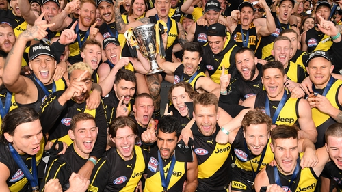 The Tigers celebrate with the Premiership Trophy