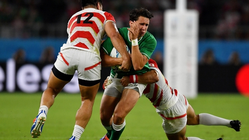 Joey Carbery is tackled by Ryoto Nakamura (l) and Shota Horie