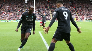 Liverpool's Georginio Wijnaldum celebrates scoring with team-mate Roberto Firmino