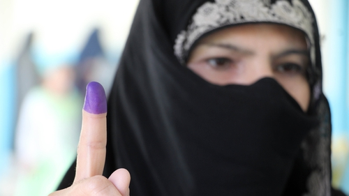 After casting their vote, many Afghans held up their fingers stained in indelible ink to show they had cast a ballot