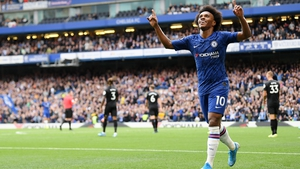 Willian celebrates Chelsea's second at the Brigde