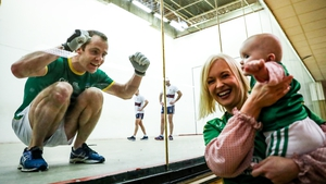 Brian Carroll celebrates as his wife Michelle and daughter Isobel look on