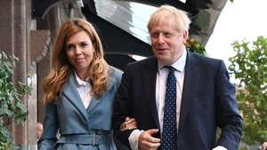 Boris Johnson and his partner Carrie Symonds arriving at the conference this evening