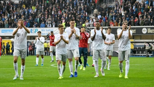 Bayern players applaud their fans after the win
