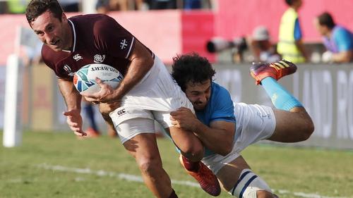 Rodrigo Silva (R) of Uruguay tackles Alexander Todua of Georgia