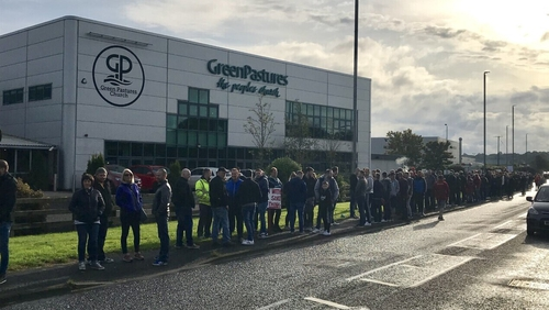 Protesters gathered outside the Green Pastures church in Ballymena, adjacent to one of the company's factories
