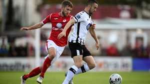 Michael Duffy of Dundalk (L) in action against Lewis Banks of Sligo Rovers