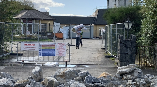 Construction workers remove materials from the former Connemara Gateway Hotel