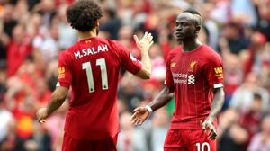Sadio Mane (R) and team-mate Mohamed Salah