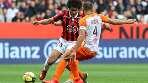 Lamine Diaby Fadiga (L, black and red shirt) in action for Nice