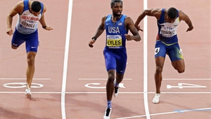 Noah Lyles (C) of the USA crosses the finish line to win the men's 200m final