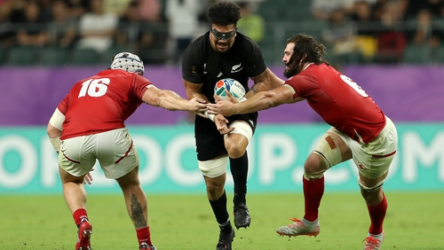 New Zealand's Ardie Savea (C) is tackled by Canada's Andrew Quattrin (L) and Lucas Rumball