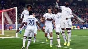 Willian leaps into the arms of Callum Hudson-Odoi as he celebrates scoring what turned out to be the winner at Stade Pierre-Mauroy