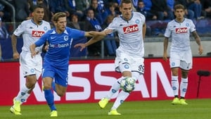 Theo Bongonda attempts to win possession off Napoli's Arkadiusz Milik at the Luminus Arena in Belgium
