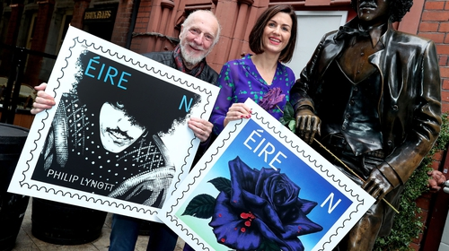 Jim Fitzpatrick and Aoife Beirne, An Post, Chief of Staff pictured at the Phil Lynott statue in Dublin