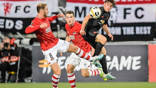 Teun Koopmeiners (L) of AZ Alkmaar competes with Daniel James of Manchester United for the ball