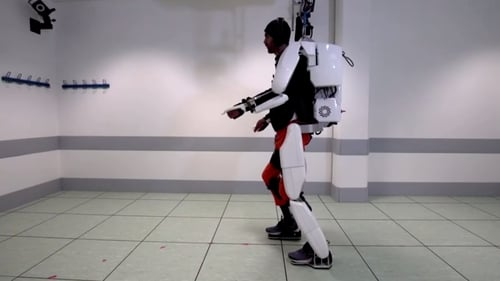 Paralyzed man from France walks using brain-controlled robotic suit