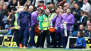 Hugo Lloris is stretchered off