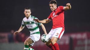 Regan Donelon of Sligo Rovers in action against Jack Byrne of Shamrock Rovers