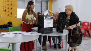 A woman casts her vote at a polling station near Lisbon