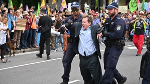 People staged a sit-in on a busy inner-city road in Sydney where some were arrested. Thirty people were later charged