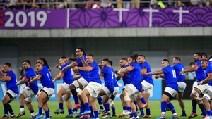 Samoa players perform Siva Tau before kick-off against Scotland
