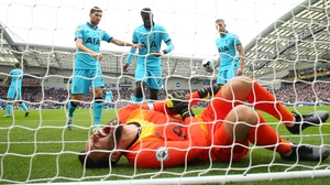 Lloris was left writhing in pain after Brighton's first goal