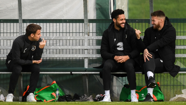 Matt Doherty share a joke with Seamus Coleman and Derrick Williams at the Ireland training session