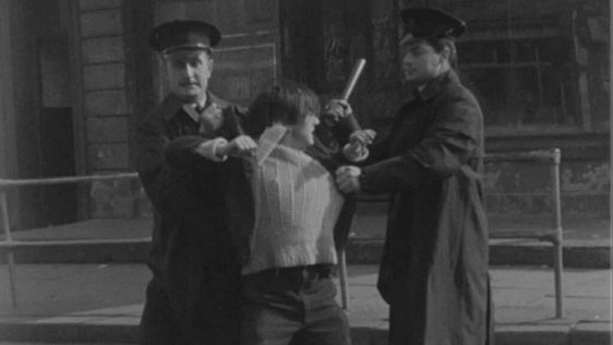 Protestor is restrained by RUC officers, Divis Street, Belfast (1964)