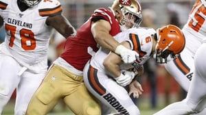 San Francisco 49ers defensive end Nick Bosa (C) sacks Cleveland Browns quarterback Baker Mayfield (R)