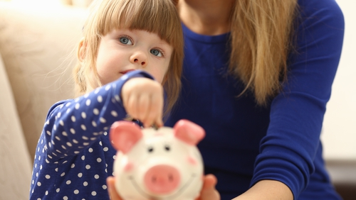 Lead by example when teaching your children about money. Photo: Getty